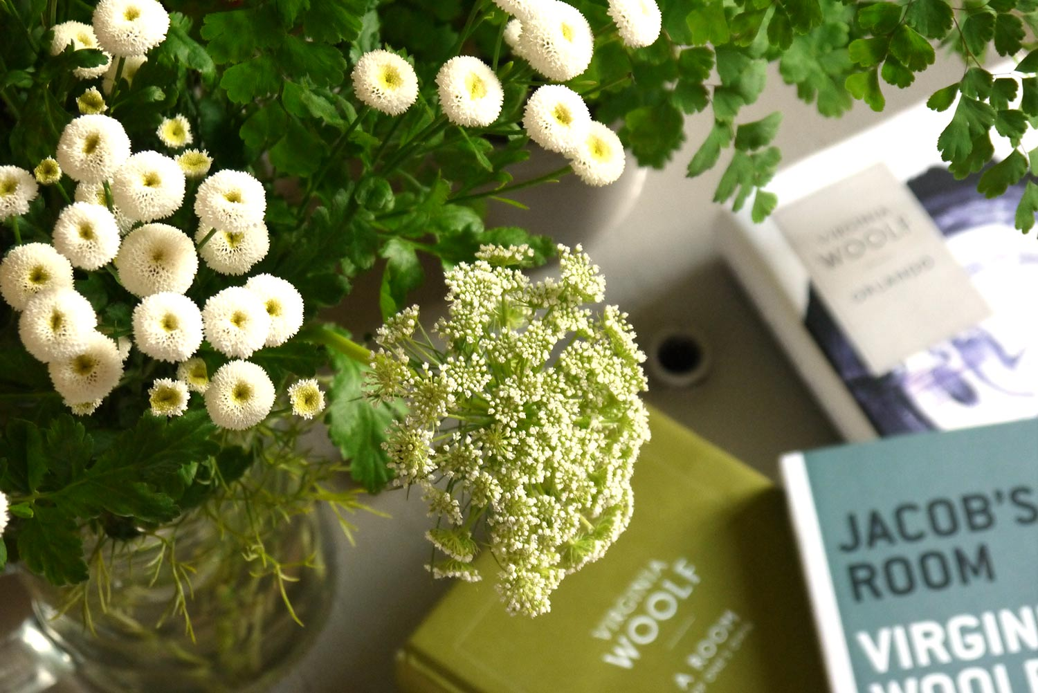 Flowers with several editions of Virginia Woolf's works