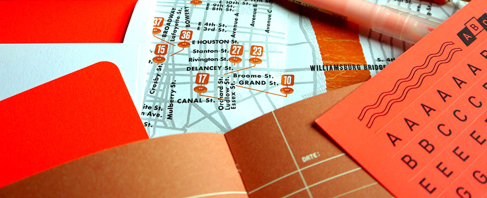 A selection of orange stationery